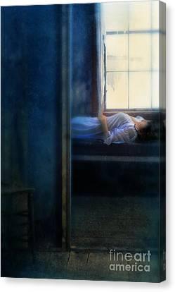 Woman In Nightgown In Bed By Window Canvas Print by Jill Battaglia