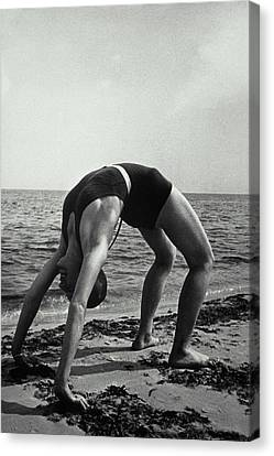 Woman In Wet Swimsuit Does A Backbend Canvas Print by Archive Holdings Inc.