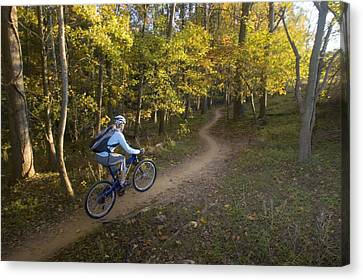 Woman Mountain Biker Rides Singletrack Canvas Print by Skip Brown