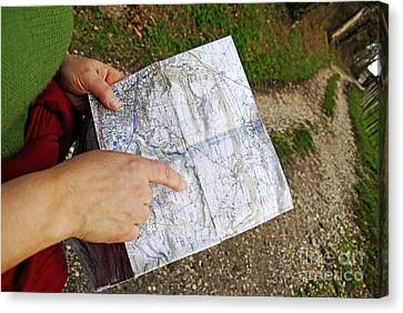 Woman On Country Road Pointing Map Canvas Print by Sami Sarkis