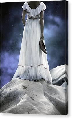 Woman On Rocks Canvas Print by Joana Kruse