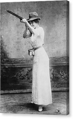 Woman Posed With Shotgun Canvas Print by Everett