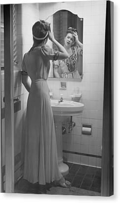 Domestic Bathroom Canvas Print - Woman Suffering Headache Standing In Front Of Bathroom Mirror, (b&w) by George Marks