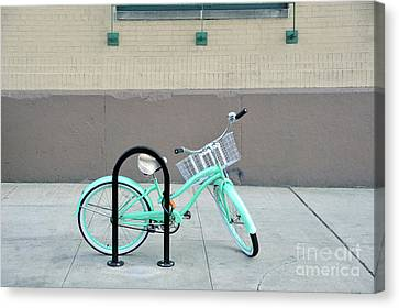 Woman's Bicycle  Canvas Print by Ed Rooney