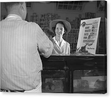 Women At Grocery Store Meat Counter. A Canvas Print by Everett