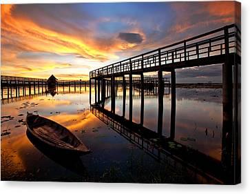 Wood Bridge In Sunset Thailand Canvas Print by Arthit Somsakul