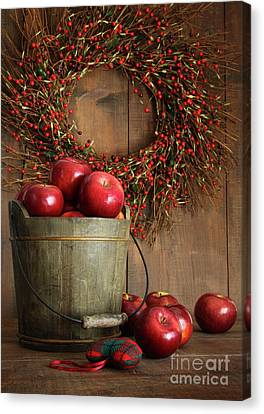 Wood Bucket Of Apples For The Holidays Canvas Print by Sandra Cunningham