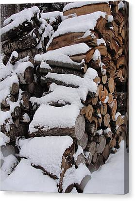 Canvas Print featuring the photograph Wood Pile by Tiffany Erdman
