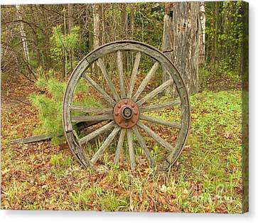 Canvas Print featuring the photograph Wood Spoked Wheel by Sherman Perry