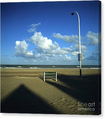 Clouds Over Sea Canvas Print - Wooden Bench In Front Of Ocean.deauville. France by Bernard Jaubert