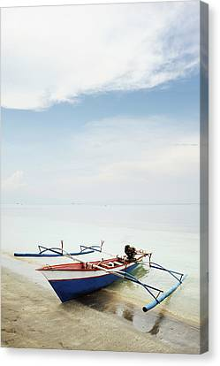 Wooden Outrigger Boat On Shore Canvas Print by Carlina Teteris