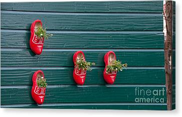 Wooden Shoes On Teh Wall Canvas Print by Carol Ailles