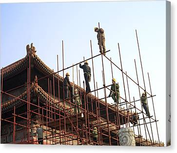 Workers Climb Scaffolding On The Palace Canvas Print by Justin Guariglia