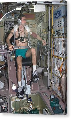 Working Out In Space. Cosmonaut Yuri Canvas Print by Everett