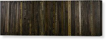 Yardsticks - Aged 18 Inch Canvas Print by Kurt Olson