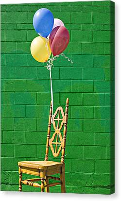 Yellow Cahir With Balloons Canvas Print by Garry Gay
