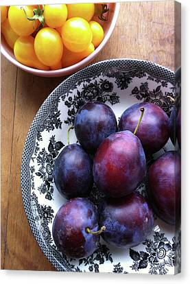 Yellow Cherry Tomatoes And Plums Canvas Print by Laura Johansen