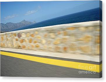Yellow Line On A Coastal Road By Sea Canvas Print by Sami Sarkis