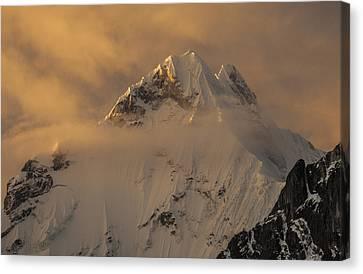 Yerupaja Summit Ridge 6617m At Sunset Canvas Print by Colin Monteath