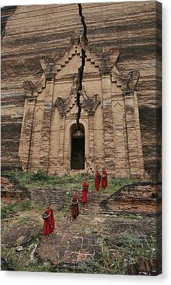 Young Buddhist Monks Near A Ruined Canvas Print by Paul Chesley