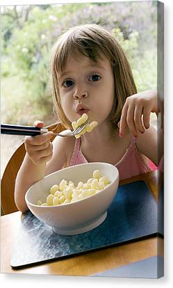 Young Girl Eating Pasta Canvas Print