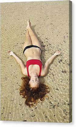 Young Woman On Sand Canvas Print by Kicka Witte
