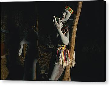 Zulu Women Put On Body And Facial Canvas Print by Chris Johns