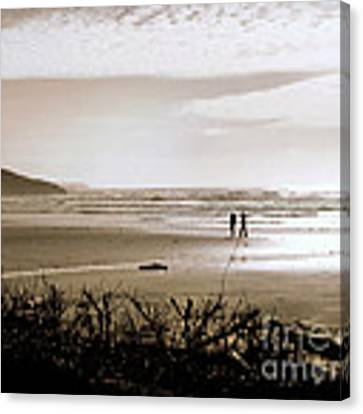 Sand And Silhouettes Canvas Print by Micki Findlay