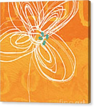 White Flower On Orange Canvas Print