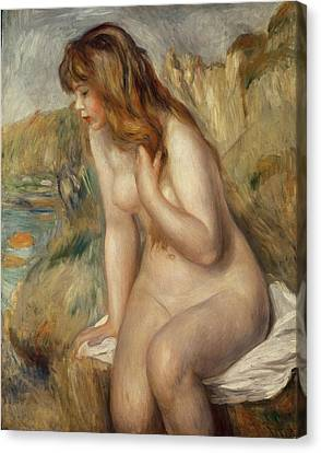 Bather Seated On A Rock Canvas Print by Pierre Auguste Renoir