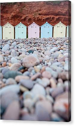 Beach Huts And Pebbles Canvas Print