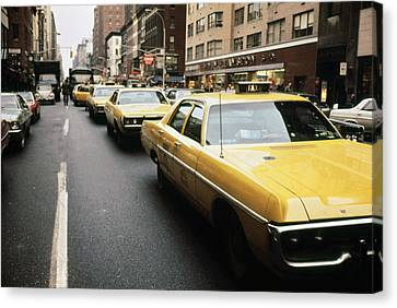 1970s America. Yellow Taxi Cabs Canvas Print by Everett