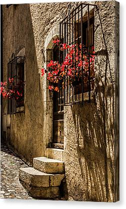 A Barred Window And Door With Red Begonia And Contrasty Shadows Saint Paul De Vence France Canvas Print