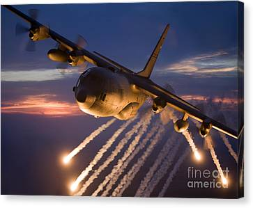 On The Move Canvas Print - A C-130 Hercules Releases Flares by HIGH-G Productions