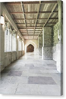 A Cathedral Corridor Canvas Print by Tom Gowanlock