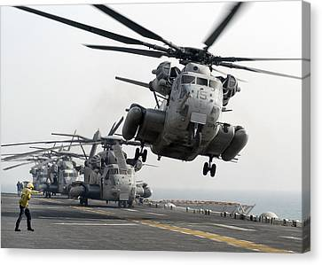 A Ch-53e Super Stallion Lifts Canvas Print by Stocktrek Images