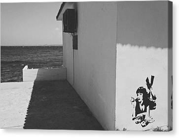 A Street Scene In Bozcaada Canvas Print by Ilker Goksen