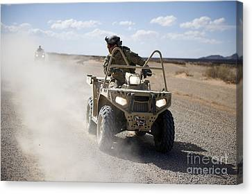 Two Wheeler Canvas Print - A U.s. Soldier Performs Off-road by Stocktrek Images
