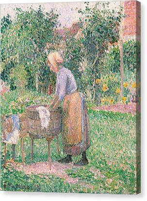 A Washerwoman At Eragny Canvas Print by Camille Pissarro