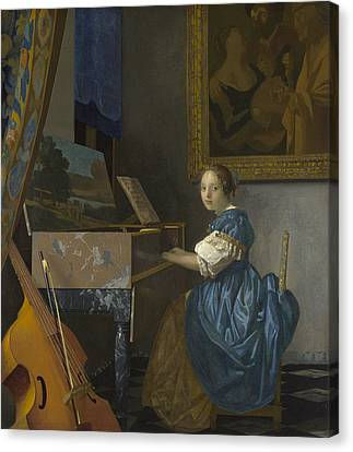 A Young Woman Seated At A Virginal Canvas Print by Johannes Vermeer