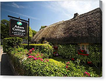 Adare Thatch Roof Cottages Ireland Canvas Print by Pierre Leclerc Photography