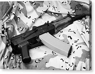 Ak-47u On Old Persian Gulf War Desert Battle Dress Uniform Canvas Print by Joe Fox
