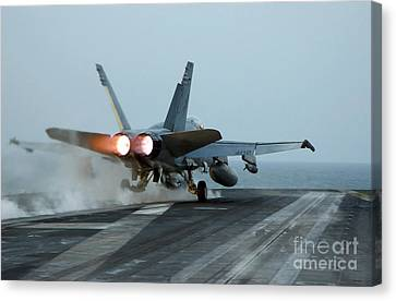 An Fa-18 Hornet Launches Canvas Print by Stocktrek Images