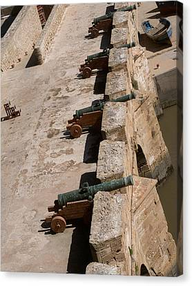 Antique Cannon Lined Up On The City Canvas Print by Panoramic Images