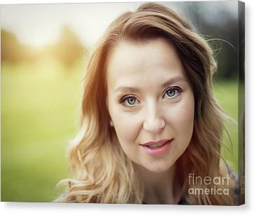 Attractive Woman Portrait. Face Expression In Sunshine. Canvas Print by Michal Bednarek