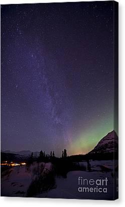 Aurora Borealis And Milky Way Canvas Print by Jonathan Tucker