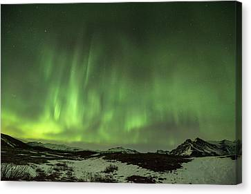 Aurora Borealis Or Northern Lights. Canvas Print by Andy Astbury