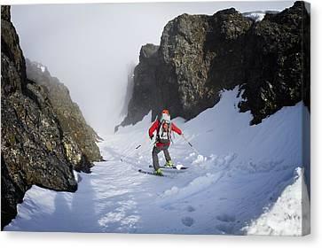 Backcountry Skier On West Twin Peak Canvas Print by Joe Stock