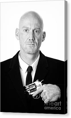 Bald Headed Man Wearing Heavy Black Overcoat Showing Revolver In Inside Pocket  Canvas Print by Joe Fox
