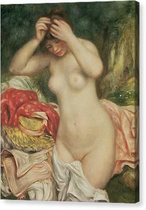 Bather Arranging Her Hair Canvas Print by Pierre Auguste Renoir